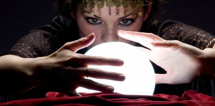 A fortune teller looking int o a crystal ball