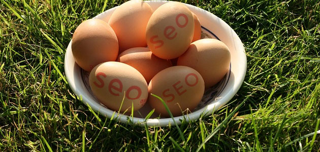 Free range eggs in field with seo text overlaid