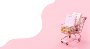 A shopping trolley against a pale pink background filled with posh shopping bags.