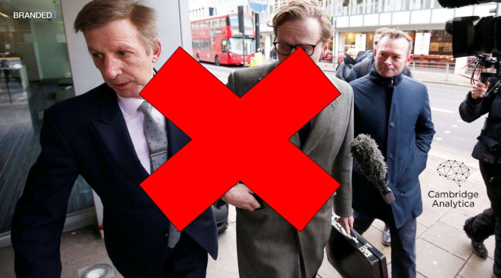 Photo of the Cambridge Analytica guys with a big red cross over it