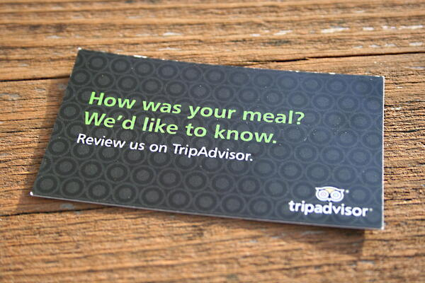Card asking to review your meal from Trip Advisor
