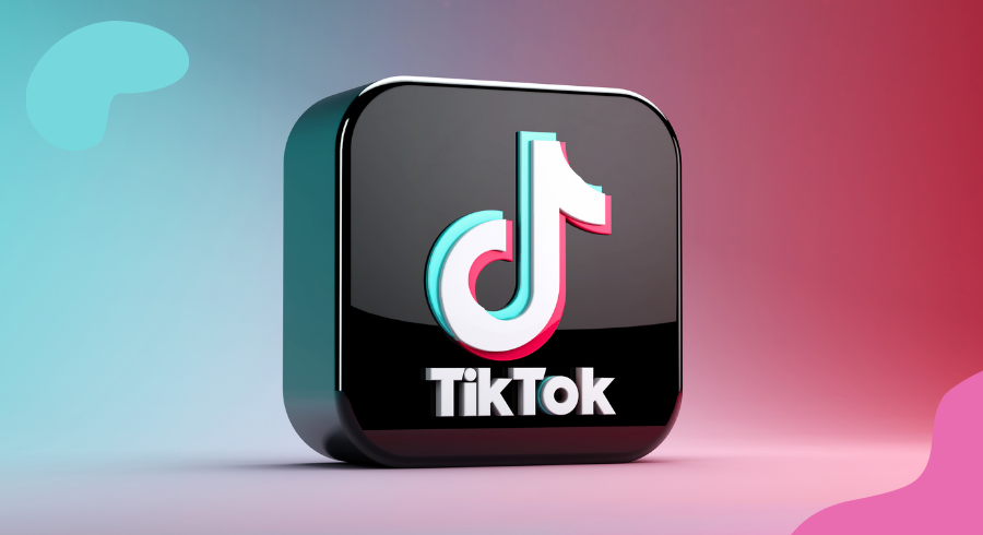 An image of the TikTok logo in a black 3D cube stacked in front of a pink and blue gradient background.