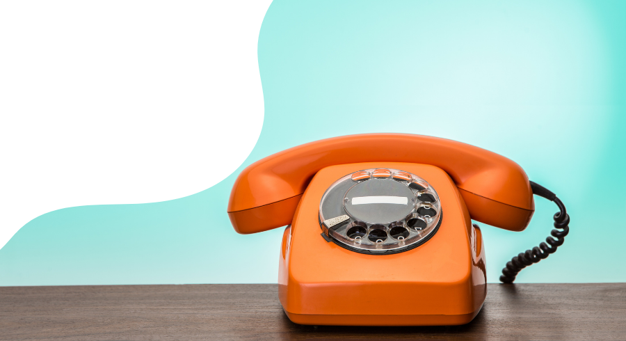 A photo of an orange phone on a blue background